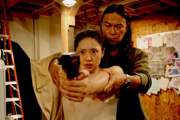 Mayumi drillas av Mastermind till att bli ett mänskligt vapen.