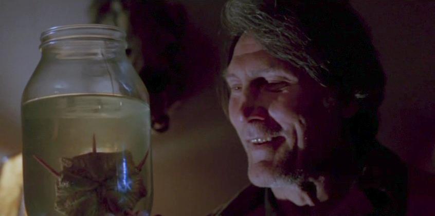 Den suspekta mackägaren Joe (Jack Palance)
