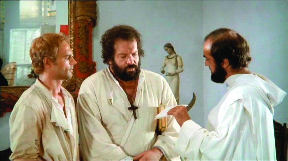 Filmens två fromma knytnävsmissionärer - tvålfagre Terrence Hill (Mario Girotti) och grove Bud Spencer (Carlo Pedersoli).
